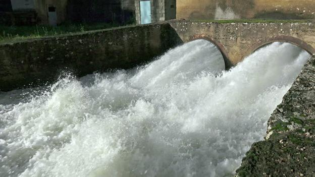Pipe Overflowing Into Canal.jpg