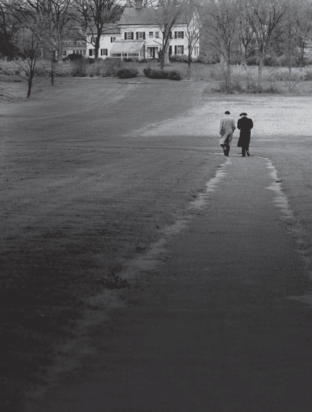 Kurt Godel, right, Albert Einstein, left, taking a walk in Princeton, 1954.jpg